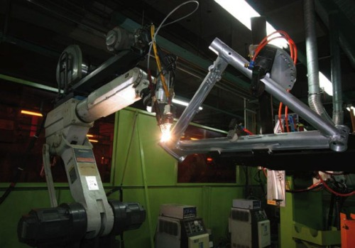 Automated robot welder at Merida - Taiwan tacking a full suspension frame.